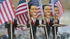 Obama figurines for sale near the Time Warner