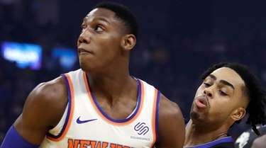 The Knicks' RJ Barrett keeps the ball from