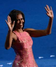 First lady Michelle Obama waves as she takes