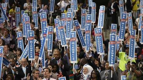 Delegates cheer as First Lady Michelle Obama addresses
