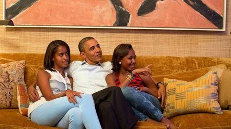 President Obama and his daughters, Malia and Sasha,