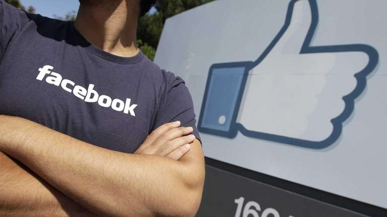 A Facebook worker waits for friends to arrive