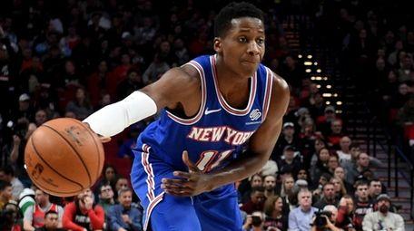 Knicks guard Frank Ntilikina, left, passes the ball