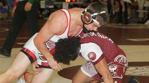 Patchogue Medford's Danny Horton wrestles Bay Shore's Keon