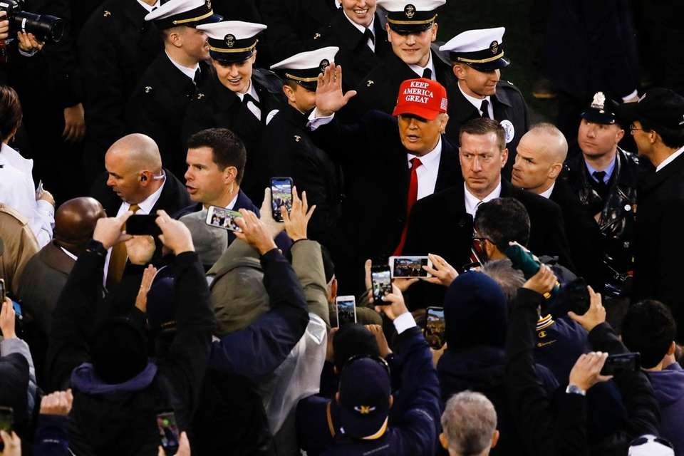 President Donald Trump waves after crossing the field