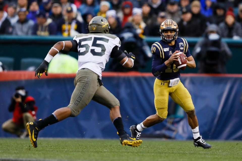Navy quarterback Malcolm Perry looks to pass as