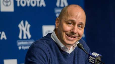 Yankees GM Brian Cashman speaking at a news