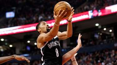Nets guard Spencer Dinwiddie drives to the hoop