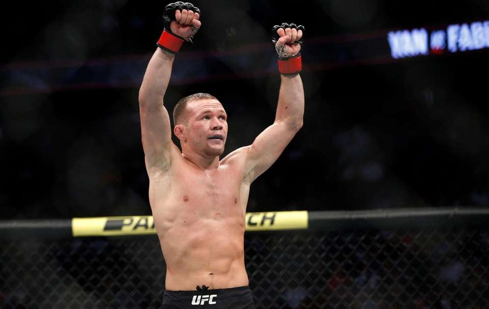 Petr Yan celebrates after defeating Urijah Faber in