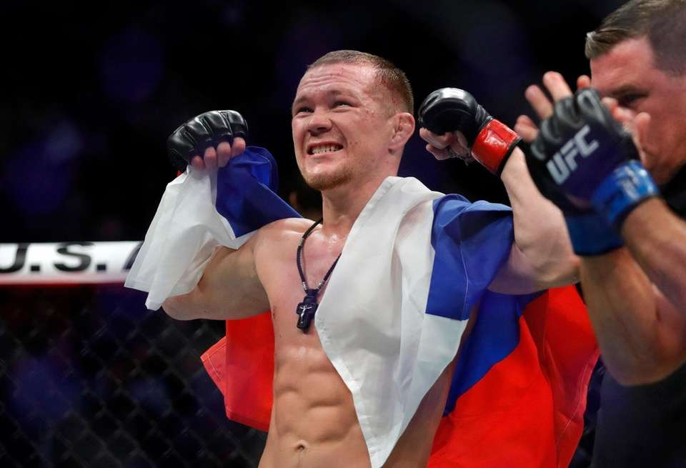 Petr Yan celebrates his victory over Urijah Faber