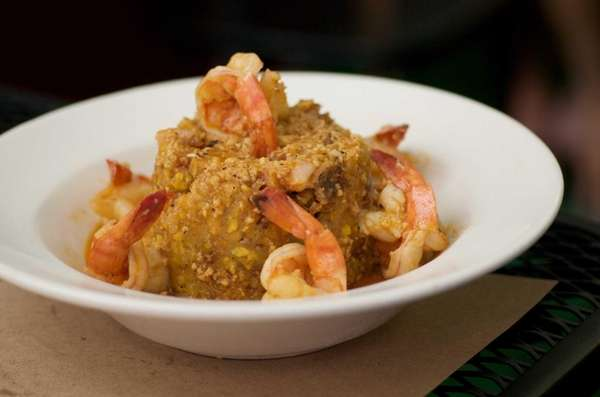 Dominican Restaurant 5 offers monfongo de cerdo, a