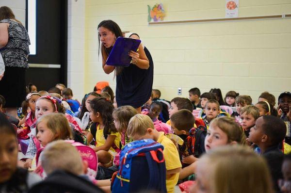 Kindergarten teacher Toni-Anne Flynn helps students get organized