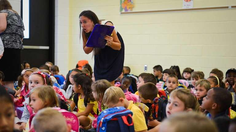 Kindergarten teacher Toni-Anne Flynn helps students get organized