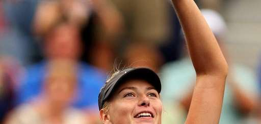 Maria Sharapova of Russia reacts after defeating Marion