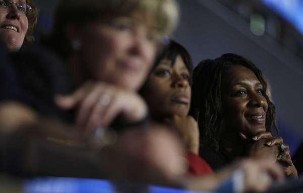 Delegates listens as first lady Michelle Obama addresses