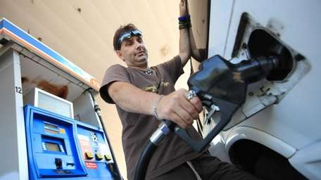 Mike Albanese of Hauppauge fills up his pickup