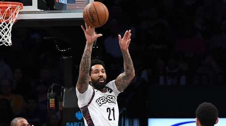 Nets forward Wilson Chandler passes the ball out