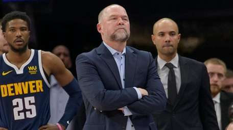 Nuggets head coach Michael Malone watches from the