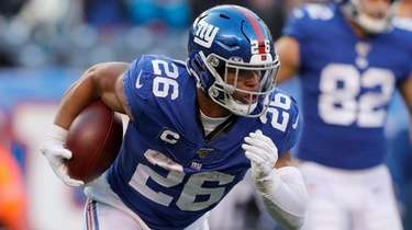 Saquon Barkley of the Giants runs the ball