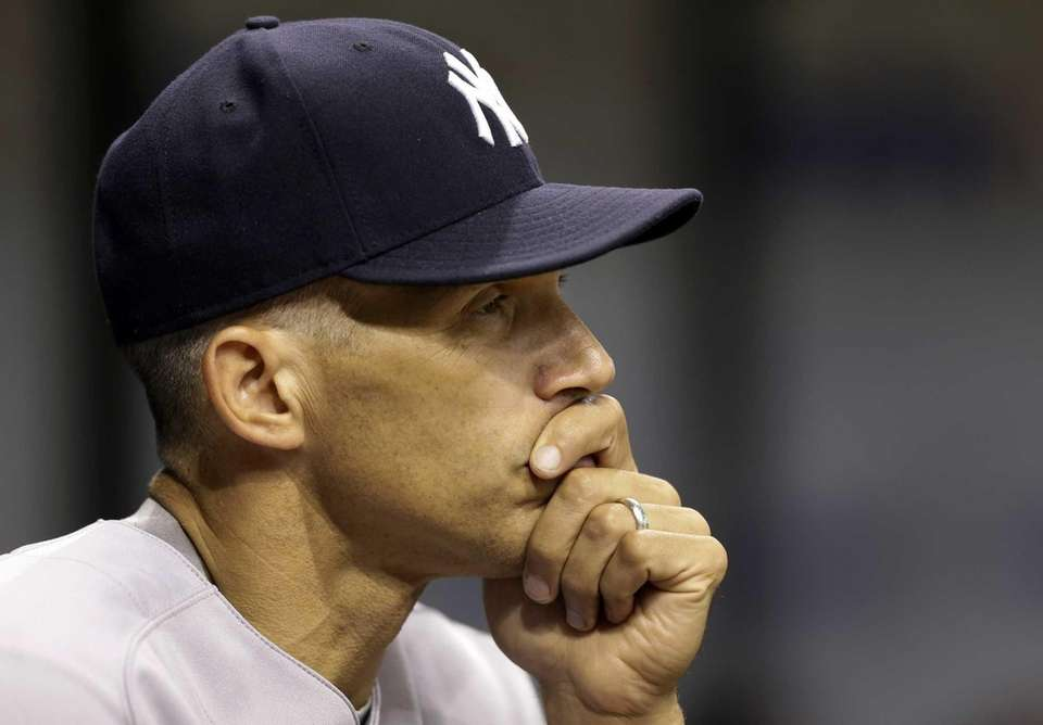 Joe Girardi watches the first inning of a