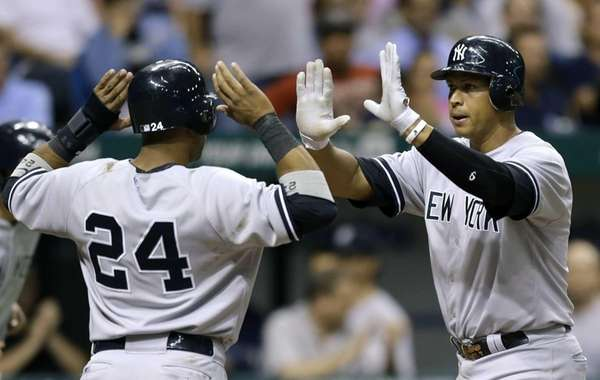 Robinson Cano, left, and Alex Rodriguez celebrate after