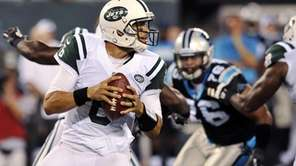 Mark Sanchez looks to pass during the first