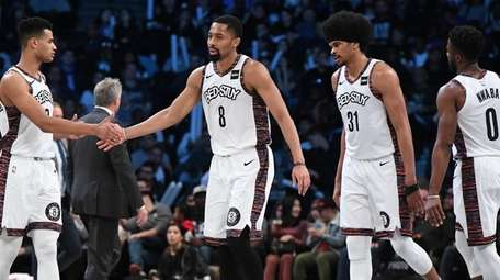 Nets guard Spencer Dinwiddie slaps five with Timothe
