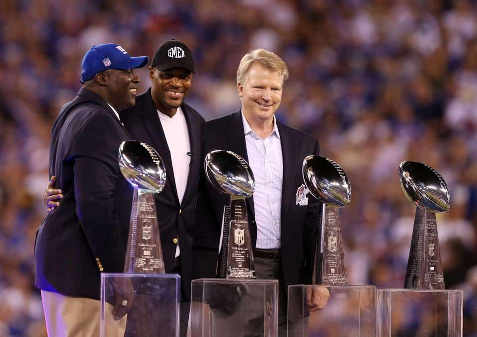 From left, Otis Anderson, Michael Strahan and Phil