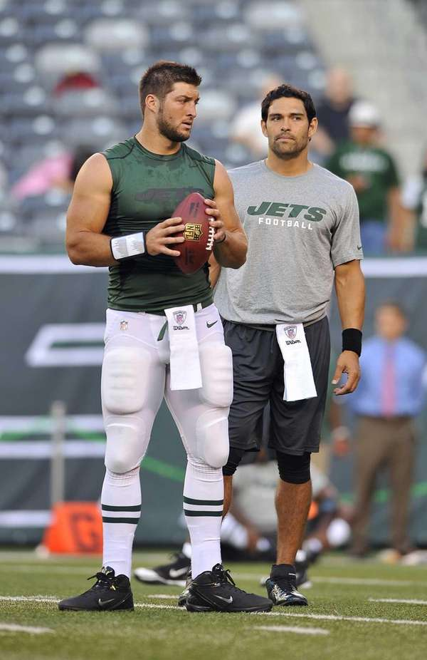 Tim Tebow and Mark Sanchez together before a