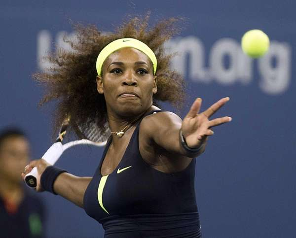 Serena Williams hits a forehand against Ana Ivanovic