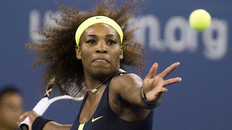 Serena Williams hits a forehand against Ana Ivanovic