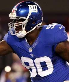 Jason Pierre-Paul celebrates after making a tackle in