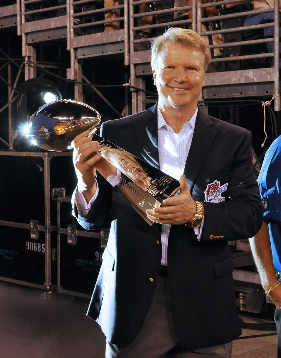Super Bowl XXI MVP Phil Simms holds the