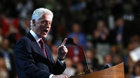 Former U.S. President Bill Clinton speaks on stage