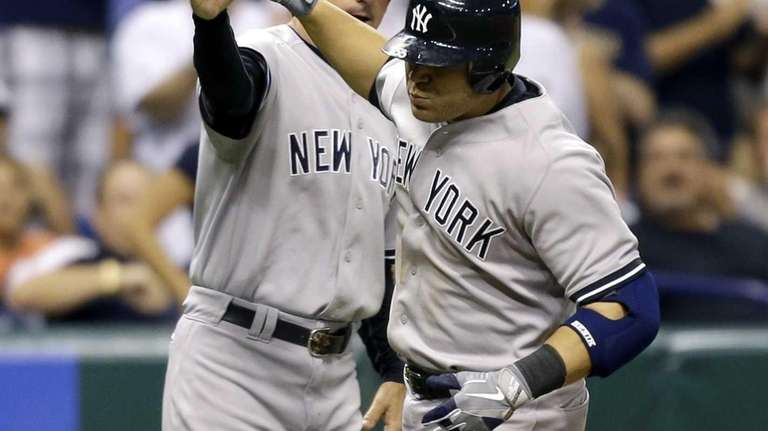 Russell Martin, right, high-fives third base coach Rob