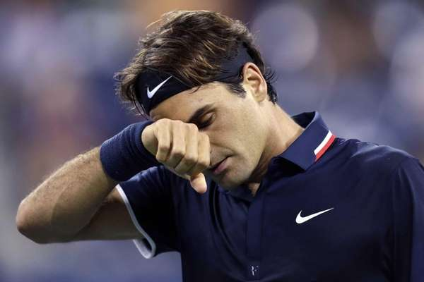 Roger Federer wipes his brow late in the
