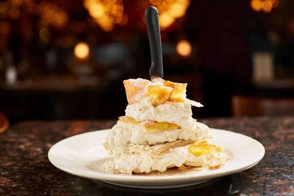 Bavarian cream dominates the sky-high napoleon, a monumental