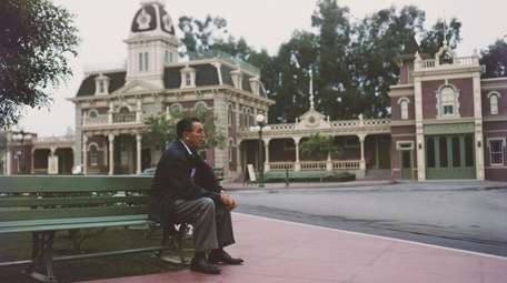 Walt Disney in an uncharacteristically empty Town Square,