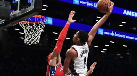 Brooklyn Nets guard Spencer Dinwiddie dunks over Philadelphia
