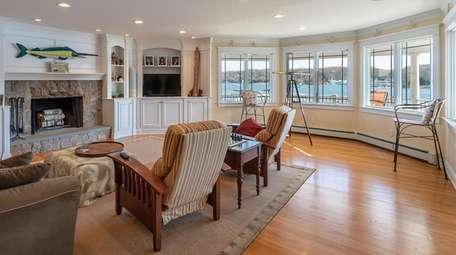 The family room features ornate woodwork and a
