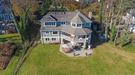 A custom-built, three-story Centerport home with twin piers