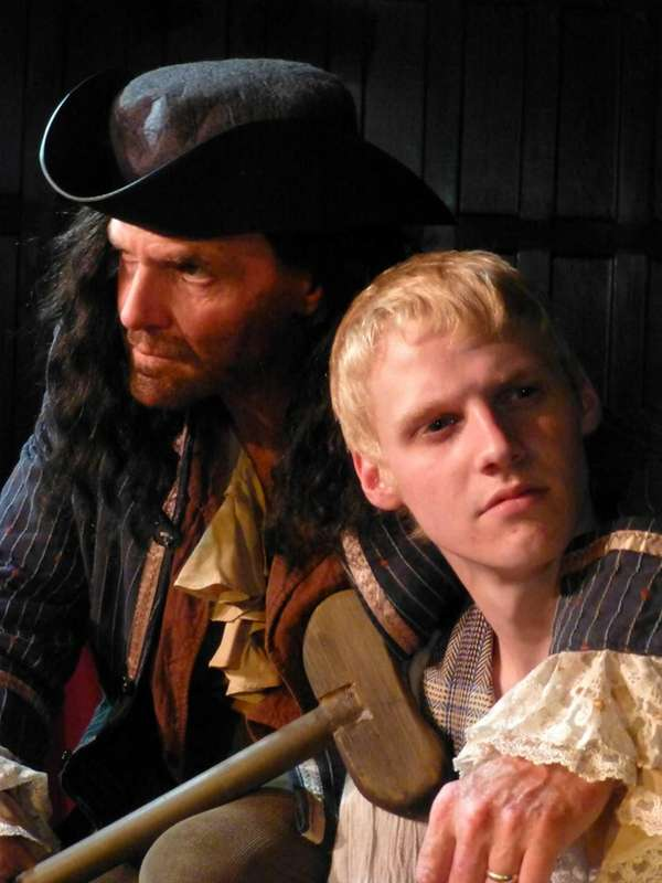 Steve McCoy, left, as Long John Silver and