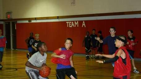 Students learned basketball skills and good sportsmanship at