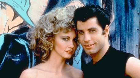 Olivia Newton-John as Sandy and John Travolta as