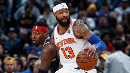 Knicks forward Marcus Morris Sr., front, picks up