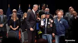 New York City Mayor Bill de Blasio honors individuals