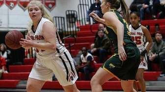 Floral Park's Amanda Kozak ;looks to pass around