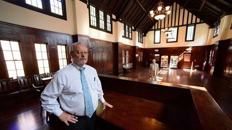North Shore Historical Museum president Brian Mercadante stands