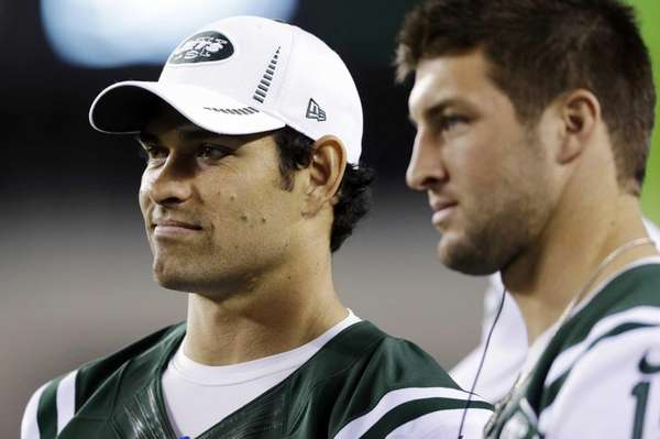 New York Jets quarterbacks Mark Sanchez, left, and