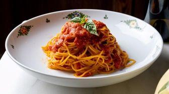 Spaghetti pomodoro garnished with basil at Osteria Morini